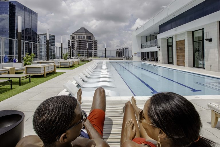 Vireo rooftop pool with people lounging